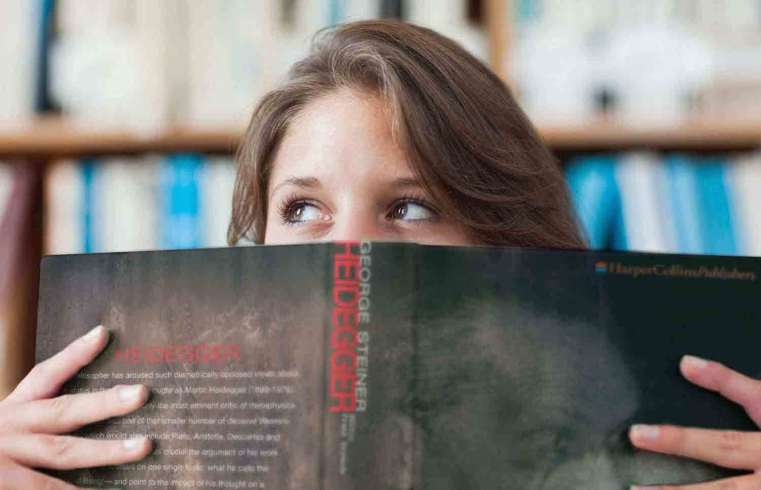 Woman Reading biographical Philosophy Book